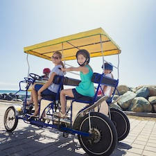 Savings coupon for Wheel Fun Rentals in Huntington Beach, California, Orange County, bike rental, cycle, travel, things to do, family